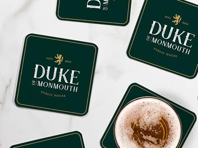 Duke of Monmouth Beer Mats bold font bold color beer branding design brand typography logo design logo brand identity branding