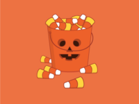 Overflowing Halloween candy bucket