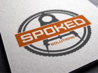 Spoked Logo