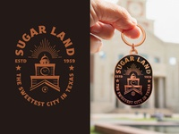 Sugar Land Badge Design & Keychain copper and black vintage style keychaindesign keychain city logo logo design badge logo city badge