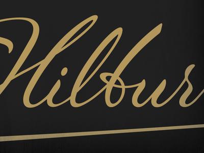 J.Hilburn Revised Script Logo