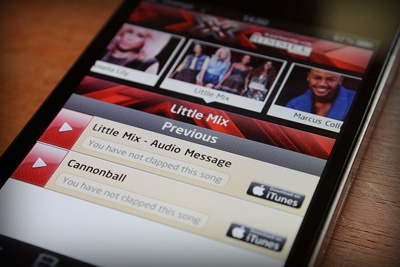 Official X Factor 2011 mobile app (iPhone showing)