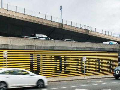 Underground @ Ink Block yellow mural design logo