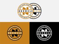 N. Brumels Logo
