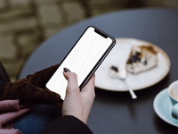 Freebie! Woman at Cafe iPhone X Mockup