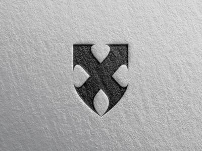 X + Shield logo concept