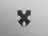 X + Shield logo concept