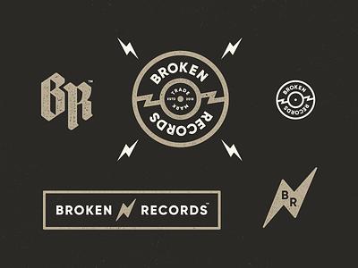 Broken Records label identity disc broken vinyl record icon logo