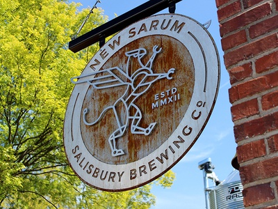 New Sarum Round Sign sign salisbury brewery beer wings griffin gryphon branding logo