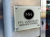 M. Weston business sign