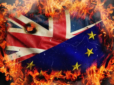 Concept of Brexit. Burning flags of UK and EU