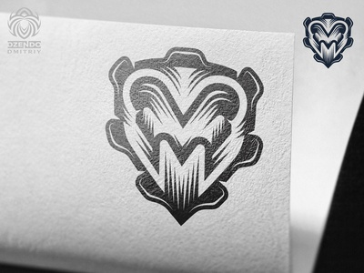 The letter M and Aries on the shield logo
