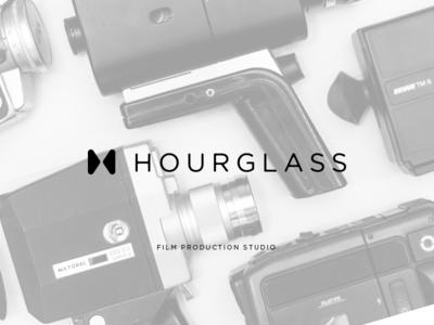 Hourglass logo mark + type