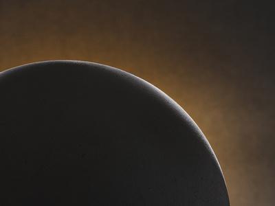 Dark days are over sphere photography branding photography moody light eclipse dark chiaroscuro ball zendesk