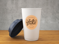 The Soft Grind logo - mock-up on coffee cup
