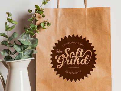 The Soft Grind logo - mock-up on paper bag