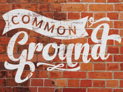 Common Ground brick red brown paint graffiti worn wall common ground script lines texture