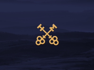 Talaton Group Logo elegant initials keys gold blue corporate identity identity emblem mark logo branding brand