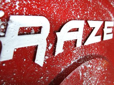 RAZE Logo on a Cast Iron Weight Plate