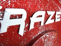 RAZE Logo on a Cast Iron Weight Plate