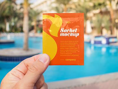 Free Sachet in a Hand Mockup antiseptic tea spice sachet foil branding design outdoor logo mockup freebie free
