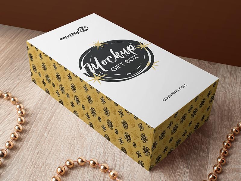 Free Gift Box MockUp in 4k table paper gold xmas christmas gift gift box box psd product mockup free