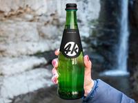 Free Glass Bottle PSD MockUp in 4k