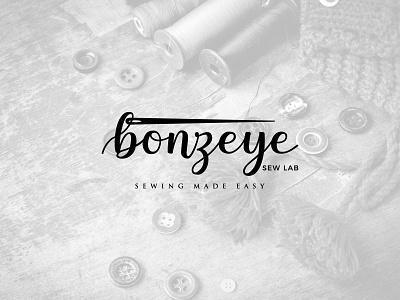 Bonzeye handwriting bonzeye design logo black and white logo design sew sewing creative wordmark logo icon vector
