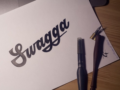 Swagga lettering artist calligraphy artist evgeny tkhorzhevsky calligraphy and lettering artist hand lettering logo lettering logo calligraphy logo type font logo calligraphy et lettering