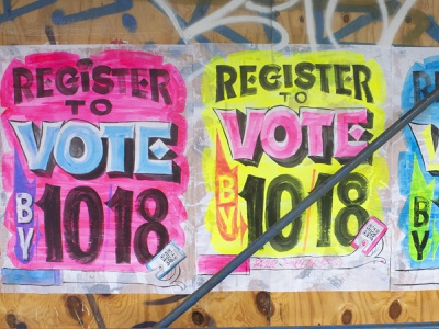 Register to vote! vote sign signage lettering texture brush public art wheat paste graffiti sign painting