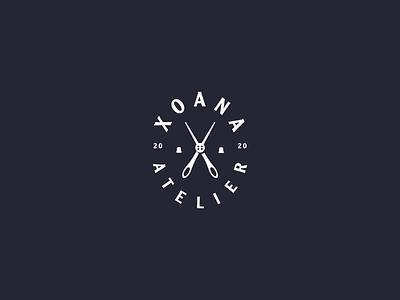 XOANA letter x button scissors needles atelier logo