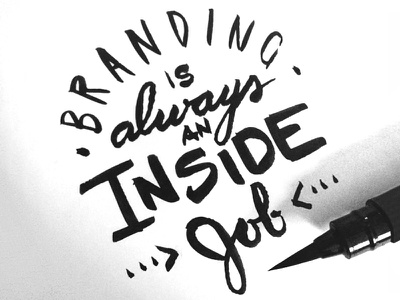 Inside Job ink script brush lettering