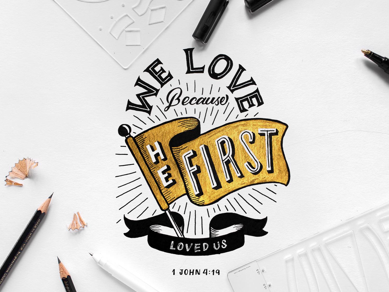 We Love Because He First Loved Us bible verse illustration gold lettering digital calligraphy design brush pen lettering composition typography type lettering hand-lettering