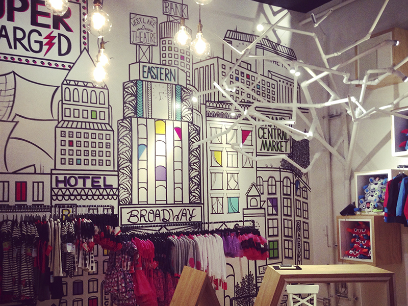 Supercharged graphic art retail interior design illustration mural apparel childrens store kids pop up boutique clothing