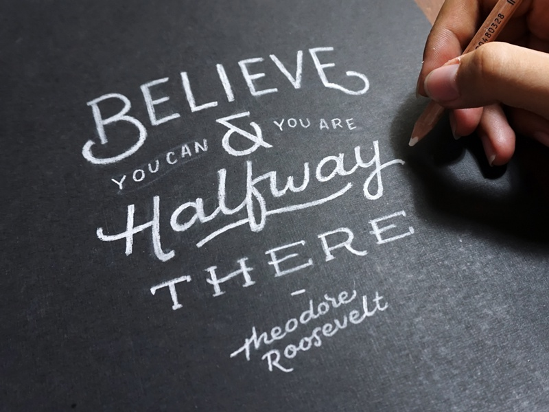 Believe black paper white pencil hand lettering typography
