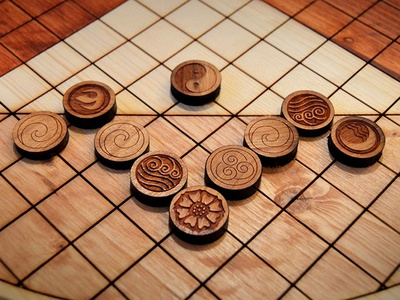 Pai Sho Game Pieces wood staining prop making pai sho laser cutting props graphics design