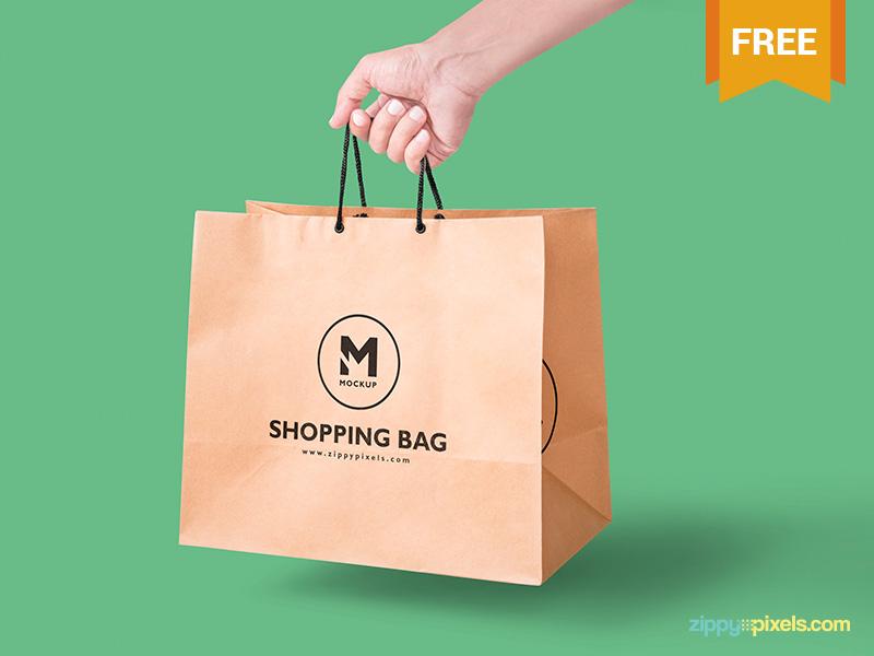 Free Handheld Paper Bag Mockup photoshop customizable presentation merchandising branding packaging shopping bag paper bag bag mockup freebie free