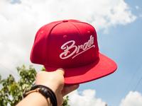 brada logo on snapback