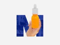 Hand holding a bottle inside the letter M
