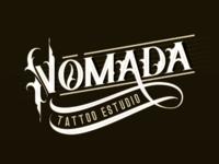 Nómada Tattoo Estudio lettering logo.