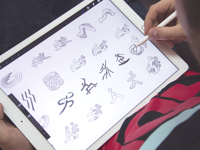 App logo sketches dynamic design icon artist working process concept stage product brandbook hand-drawn sketches pencil sketching fitness and sport application identity branding logo