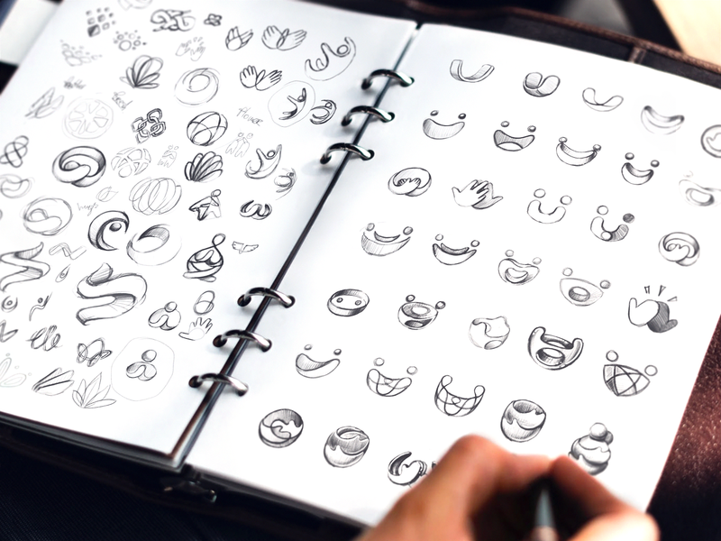 Logo Exploration sketch sketches logo design hands smile friendly shapes geometric sign mark brand identity designer traditional art shapes hand-drawn options draft shape exploration logotype symbol mark