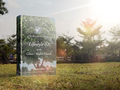 Book Mock-up - Lifestyle 02 story paperback novel mockup lifestyle hardback grass field canvas book bench