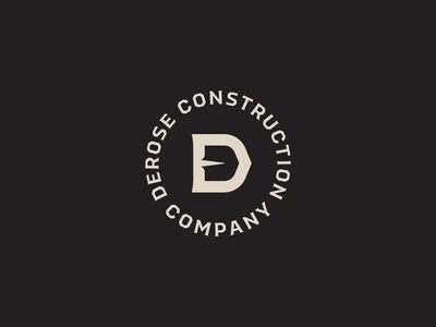DCCo shovel construction lockup logo d lettermark