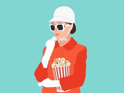 Audrey Hepburn eating popcorn