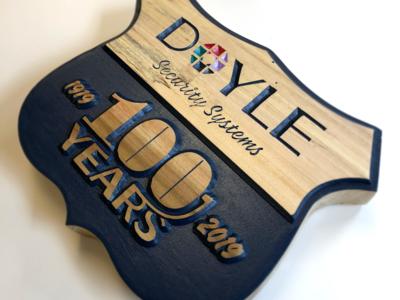 Doyle 100th Anniversary Logo on Wood