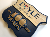 Doyle 100th Anniversary Logo on Wood identity branding corporate branding 100 centennial illustrator doyle security anniversary logo design wood block wood logo