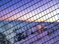 Fantastic winter sunrise in snow mountains