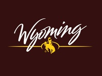 Brush hand lettered Wyoming Tourism logo