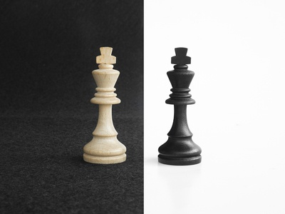 King chess pieces in black and white